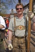 A traditionally dressed man at the Maibaumfest in the village of Putzbrunn, Southern Bavaria, Germany.
