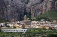 This quaint little village of Aguero in Aragon, Spain almost resembles that of a large scaled model as it sits under the massive red rock crag of the Mallos de Riglos.