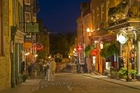 As night begins to settle in along Rues Sous le Fort in Quartier Petite Champlain in Quebec City, the lights glow amongst the shops and restaurants.