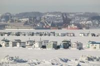 Fishing shanties on the St Lawrence River in Quebec, Canada.