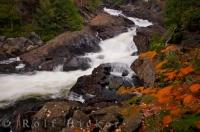 Autumn begins to take over the landscape of Oxtongue River-Ragged Falls Provincial Park in Ontario, Canada where Ragged Falls shows its fury making its way downstream.
