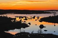 Between the two towns of Red Bay and Mary's Harbour along the Labrador Coastal Drive in Southern Labrador, a magnificent sunset highlights the sky.