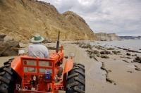 A guide will drive this red tractor along the coastal areas of Hawkes Bay on the North Island of New Zealand, taking passengers on beach tours to the Australasian Gannet Colony.