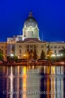 A view across Wascana Lake at the Saskatchewan Legislative Building at night in the city of Regina, the province of Saskatchewan, Canada. The building, built between 1908 and 1912 serves as the seat of the Legislative Assembly of Saskatchewan.