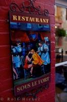 A bright colored sign outside a restaurant along Rue Sous le Fort in Quartier Petite Champlain in Old Quebec in Quebec City, Canada.