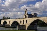 The Pont St Benezet and the Chapelle St Nicolas span across the Rhone River which flows through Avignon, France in Europe.