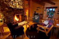 The peacefulness of the lounge at the Rifflin'Hitch Lodge in Southern Labrador, Canada where you relax by the fire and listen to the wood crackle.