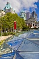 The glass roof of Robson Square is in stark contrast to the stately buildings, such as the Vancouver Art Gallery and the Fairmont Downtown Vancouver Hotel, nearby.