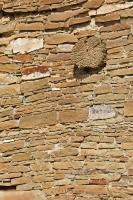 A single log of wood provides extra stability in the rock walls of Pueblo Bonito, a National Historic Site in the Chaco Canyon of New Mexico, USA.