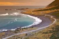 As evening approaches the coastline near Rocky Point on the North Island of New Zealand glistens in the sunset.