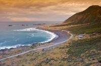 An amazing sunset over Rocky Point on the North Island of New Zealand.