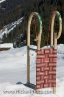A Rodel, aka toboggan, sits upright in the snow in the Wildgerlostal (Wildgerlos Valley) in Salzburger Land in Austria. These toboggans use both traditional building materials and modern technology to build a fast and exciting sled.