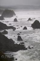 Rocks jut out along the rugged coast of California in the USA.