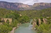 This serene section of the Gallego River in Huesca, Aragon in Spain with the ruined bridge on either bank, can become more turbulent in the higher terrain.