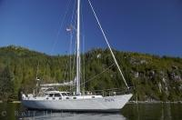 The sailing boat ANON anchored at Bligh Island in Nootka Sound on Vancouver Island, BC, Canada.