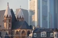 The historic church of Saint Leonards is a well preserved Catholic Church dwarfed by the tall modern buildings in the downtown area of Frankfurt, Germany.