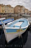 The blue and white boat tied up at the dock of Mole Jean Reveille in Saint Tropez, Provence in France is one of many which are used by the local residents.