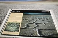 An interpetive sign explaining the sait flats in the Badwater Basin of Death Valley in California, USA.