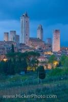 Dusk settles on San Gimignano while subtle lighting reflects on the towers which dominate the skyline of this small town in the province of Siena, in the Tuscany region of Italy.