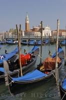 The Island of San Giorgio Maggiore with Venetian Gondolas in the foreground, in Venice, Italy.