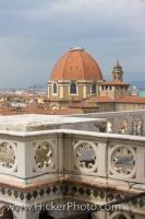 The San Lorenzo Church dome, as seen from the Duomo Campanile (bell tower), backdropped by the blue skies surrounding the city of Florence, Italy.