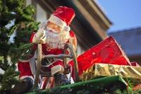 A Santa decoration adorns the top of a market stall at the Christmas markets in the town of Michelstadt in Hessen, Germany in Europe.