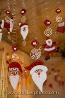 An array of Santa themed Christmas ornaments hanging down from springs or strings are on display at the christmas markets at the Hexenagger Castle in Bavaria, Germany.