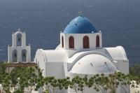 A truly classic picture of Santorini in Greece, a popular vacation destination situated in the Aegean Sea.