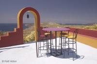 A Restaurant in Santorini has an outdoor patio area for diners to take in the wonderful view under the Mediterranean sun.
