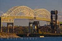 The International Bridge seen from the Soo Locks with the sunlight emitting a golden hue to the bridge as it spans the St. Mary's River in Sault Ste Marie in Ontario, Canada.