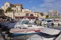 The waterfront and marina in the village of Sausset Les Pins in France is surrounded by great restaurants.