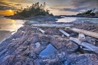 In typical West Coast style, a beautiful sunset lights the shores of the Pacific Ocean on Vancouver Island. This scenic coastal spot is South Beach in the popular Pacific Rim National Park near Tofino.