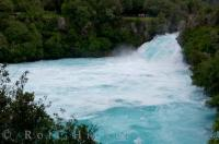 Tourists stand atop the lookout points for a scenic view of the Huka Falls as the Waikato River near Taupo on the North Island of New Zealand squeezes through a narrow passage.