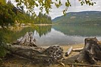 The clear waters of Sugar Lake are surrounded by scenic forested hillsides of both evergreen and deciduous trees. The deciduous trees often produce a colourful display during the fall months.