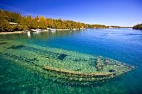 Continuing on from the tip of the Bruce Peninsula at the mouth of Georgian Bay is the pristine Fathom Five National Marine Park a protected portion of Lake Huron in Ontario, Canada littered with shipwrecks and watched over by several historic lighthouses.