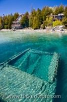 The shipwreck of the ship Sweepstakes, which was built in 1867, lies at the bottom of the Big Tub Harbour in Fathom Five National Marine Park, part of Lake Huron in Ontario. The ship is also known by the name of Sweeps.