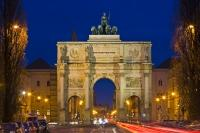 The Siegestor, also known as the Victory Gate, is a historic landmark situated in a busy area in Munich Germany as can be seen with the flowing traffic. The gate was built in 1852 and sustained some damage during bombing in WWII.