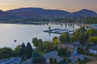 The picture shows a view of the Skaha Park and Marina, a vacation spot on the shores of Skaha Lake at sunset in Penticton, British Columbia, Canada.