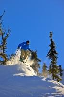 A skier gives a demo of the kind of action available when skiing on Whistler Mountain in BC, Canada.