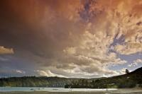 A threatening sunset of fascinating colors near Hopewell in Kenepuru Sound on the South Island of New Zealand.