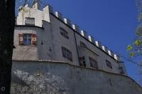 The South Tyrol castle in Bruneck, Italy sits high on a hill and can be seen from anywhere in town.