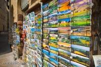Colourful postcards and other trinkets are sold at souvenir shops like this one throughout the city of Volterra, which is located in the province of Pisa, in the beautiful Tuscany Region of Italy.