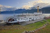 The SS Moyie, a National Historic Site, sits on a concrete berth on the scenic shores of Kootenay Lake in Kaslo, British Columbia, Canada.