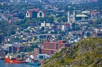The colorful buildings and houses creep up the hillsides in the city of St. John's on the Avalon Peninsula in Newfoundland Labrador.