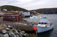 A fishing boat docks along the coastline of St. Lunaire-Griquet in Newfoundland, Canada as pack ice still lingers in the harbour.