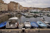 Colourful boats in varying shapes and sizes line the marina in the harbour of St Tropez in the Provence region of France.