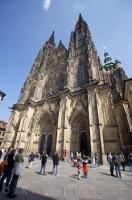 The Gothic architecture on the facade of St. Vitus Cathedral at Prague Castle in the Czech Republic glistens in the sunlight. The cathedral is the biggest and most important one found throughout the country.