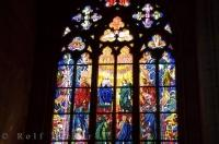 Sunlight shines through a stained glass window of the church in the famous Prague Castle in Prague in the Czech Republic.