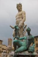 The Statue of Neptune surrounded by other ocean deities in the Piazza della Signoria in the city of Florence, Italy is one of many works of art in this outdoor museum which is a popular tourist attraction.