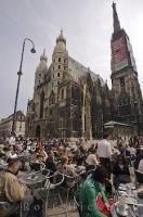 Many people relax at a cafe at the Stephansplatz near Stephansdom in downtown Vienna, Austria.